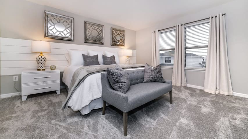 Spacious & luxurious 2nd-floor master bedroom w/king bed & plush carpet for comfort.