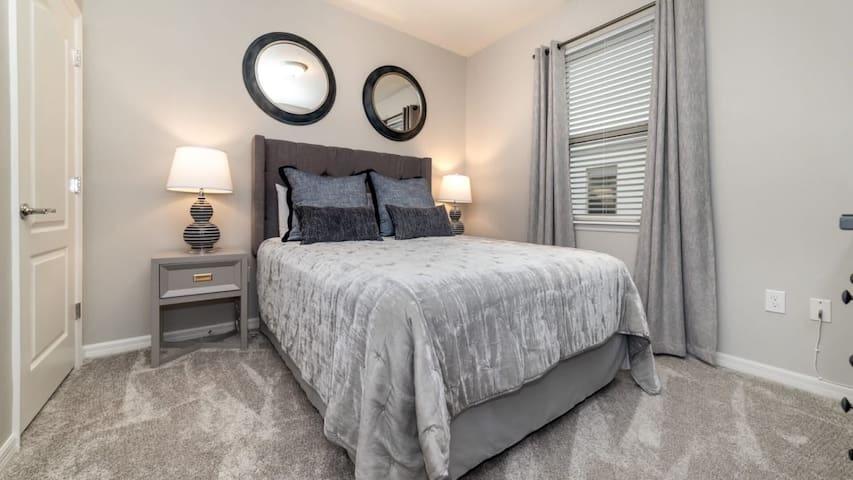 Bedroom 3 is the ground-floor queen bedroom, w/wall-mounted flatscreen TV