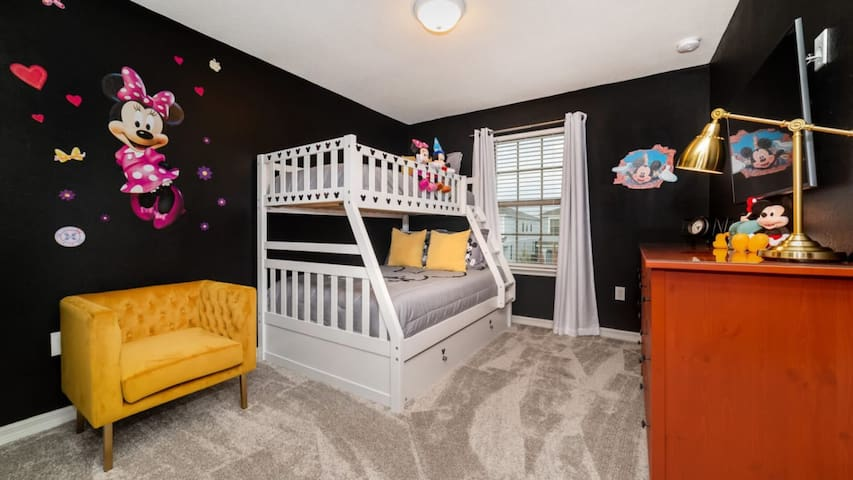 Bedroom 4 is a Mickey/Minnie-themed room! Furnished with a double/twin bunk bed.