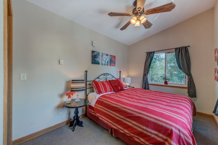 The Red Rose bedroom offers a comfortable queen bed and intriguing artwork.