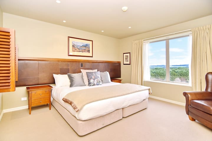 Bedroom 1 has a California King bed with a sitting area and an en suite bathroom