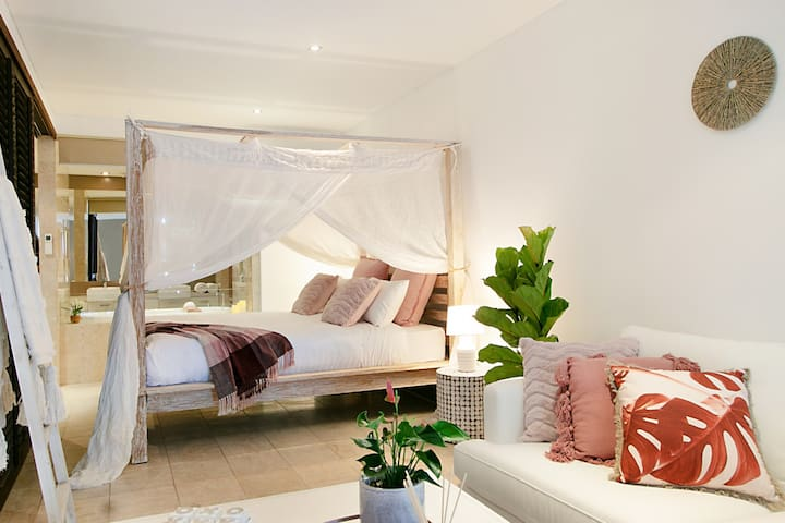 The luxurious canopy bed is the highlight of this stylish unit