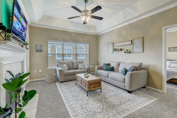 Living room with Full Sleeper Sofa and SMART TV. YouTube TV will be provided. :)