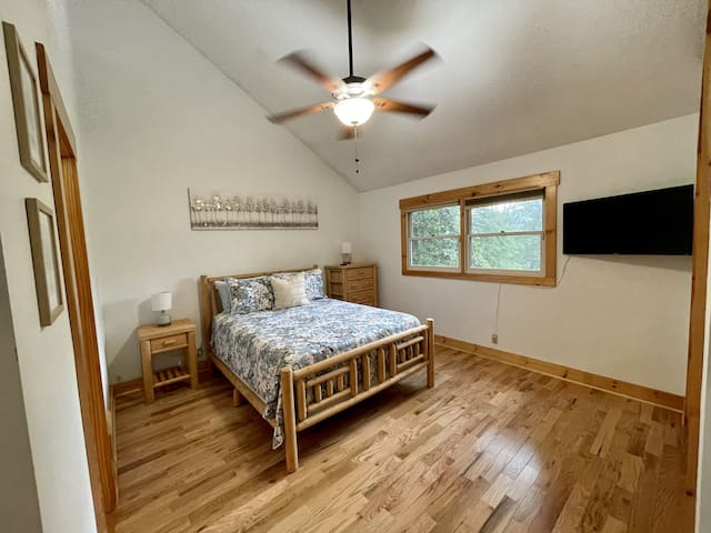 Upstairs Queen guest room #2. Large closet near Roku TV with a dresser and lots of room for hanging clothes.