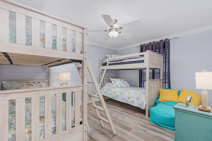Stash away the kids in this room with double bunk beds.