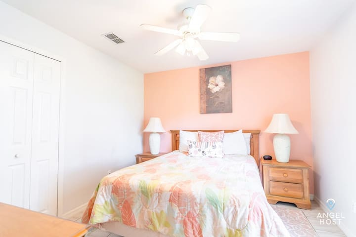 Bedroom 3 is a peachy fun queen room with ample closet space.