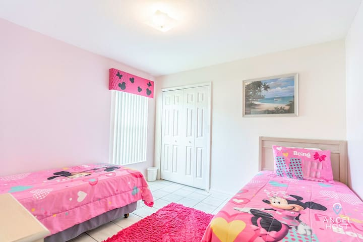 Look at bedroom 4! It's a pink 2-twin bed Minnie Mouse room!