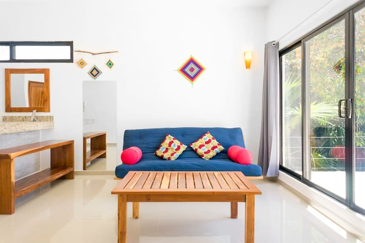 A cheerful space with handmade wooden furnishings and local art accents.