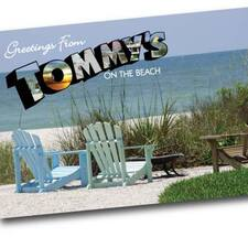 Jan@Tommysonthebeach.Com is the host.
