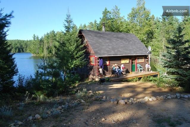 Log Cabin On A Lake In Lac Saint Paul